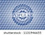 popular blue emblem with... | Shutterstock .eps vector #1131946655