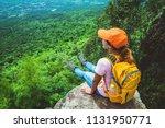 women asians travel relax in... | Shutterstock . vector #1131950771