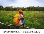 asian woman travel nature.... | Shutterstock . vector #1131952379