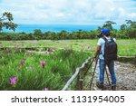 asian men travel nature. travel ... | Shutterstock . vector #1131954005