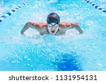 Teenage Swimmer Swimming...