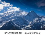 snow covered peaks in the...