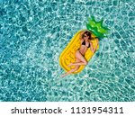 attractive woman in bikini... | Shutterstock . vector #1131954311