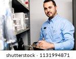 merchandiser checking products... | Shutterstock . vector #1131994871