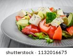 greek salad with vegetables and ... | Shutterstock . vector #1132016675