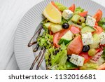 greek salad with vegetables and ... | Shutterstock . vector #1132016681
