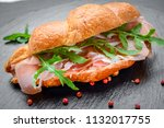 fresh croissant with ham and... | Shutterstock . vector #1132017755