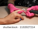 polishing of nailswith help of... | Shutterstock . vector #1132027214