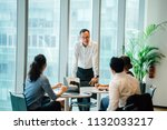 a chinese asian manager is... | Shutterstock . vector #1132033217