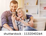 happy young couple taking... | Shutterstock . vector #1132040264