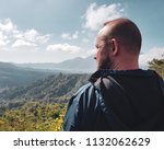 back view of man tourist admire ... | Shutterstock . vector #1132062629