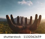 hand shaped sculpture with... | Shutterstock . vector #1132062659