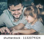 dad plays with his little... | Shutterstock . vector #1132079324