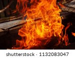 fire brazier on nature bones... | Shutterstock . vector #1132083047