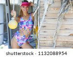 young sexy woman wearing cap... | Shutterstock . vector #1132088954