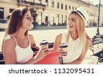 women in shopping. two... | Shutterstock . vector #1132095431
