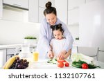 happy mother and daughter... | Shutterstock . vector #1132107761