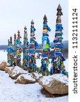 wooden ritual pillars with... | Shutterstock . vector #1132111124