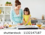 family  cooking and people... | Shutterstock . vector #1132147187