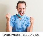 senior doctor man using mask... | Shutterstock . vector #1132147421