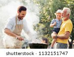 happy family having barbecue... | Shutterstock . vector #1132151747