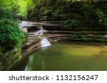 a beautiful waterfall in the... | Shutterstock . vector #1132156247