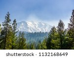 smoke carried by the wind from... | Shutterstock . vector #1132168649