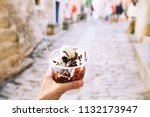 tourist holds in hand fritule ... | Shutterstock . vector #1132173947