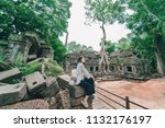 young female tourist wearing a... | Shutterstock . vector #1132176197