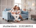 kissing mother. loving little... | Shutterstock . vector #1132180511