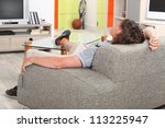 man at home on his sofa | Shutterstock . vector #113225947