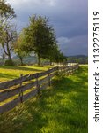 wooden fence at paddock in... | Shutterstock . vector #1132275119
