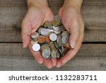 two hands carry coin money with ... | Shutterstock . vector #1132283711