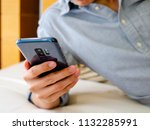 asian man relaxing with holding ... | Shutterstock . vector #1132285991