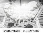 happy couple in loungers by the ... | Shutterstock . vector #1132294889