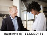 happy multi ethnic co workers... | Shutterstock . vector #1132330451