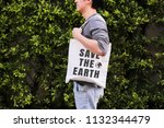 young male hipster holding and... | Shutterstock . vector #1132344479