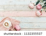 coffee cup and pink peony...   Shutterstock . vector #1132355537