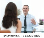 business consultant sits at his ... | Shutterstock . vector #1132394807
