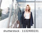portrait of a positive stylish... | Shutterstock . vector #1132400231