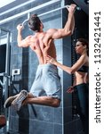 a young man doing pull ups in... | Shutterstock . vector #1132421441