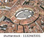 amphitheater square in lucca... | Shutterstock . vector #1132465331