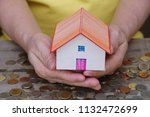 house model carry on hands with ... | Shutterstock . vector #1132472699