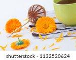 marigold or calendula herbal... | Shutterstock . vector #1132520624