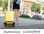 young woman with yellow carry... | Shutterstock . vector #1132529945