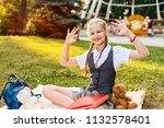 pretty schoolgirl with pigtails ... | Shutterstock . vector #1132578401