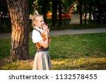 schoolgirl with pigtails in... | Shutterstock . vector #1132578455
