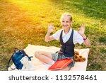 pretty schoolgirl in uniform... | Shutterstock . vector #1132578461