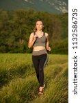 beautiful young sporty woman...   Shutterstock . vector #1132586735