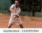 handsome retro styled tennis...   Shutterstock . vector #1132591964